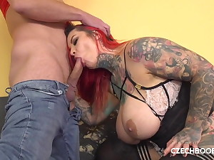 Busty tattooed bitch gets pumped