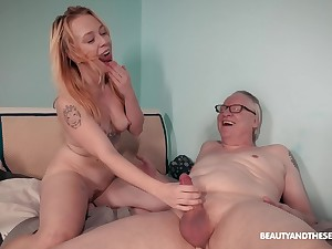 Tattooed chick Chrystal Sinn spreads her legs to ride an older man