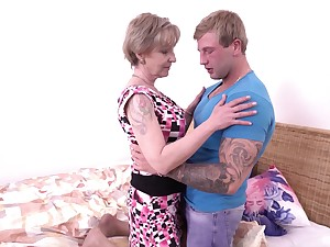 Chesty older dame Mili loves a blond boy's thick endowment